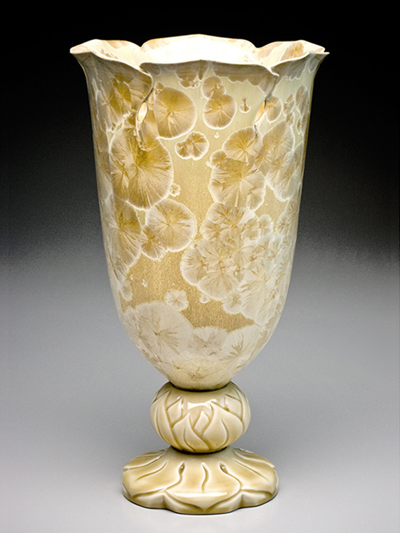 large cream and gold crystalline glazed bucket vase on carved ball and pedestal