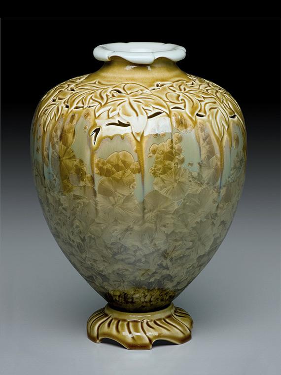olive green carved crystalline glazed vase on carved pedestal