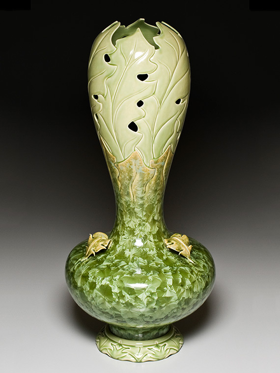 very large moss green carved crystalline glazed vase on carved pedestal